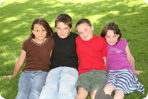 4-caucasian-kids-in-grass_c