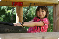 girl-in-tire-swing_c